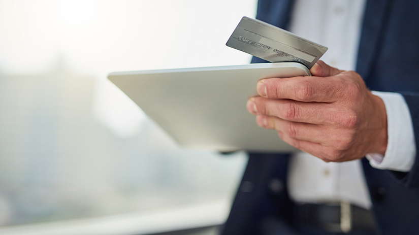 businessman paying with company card